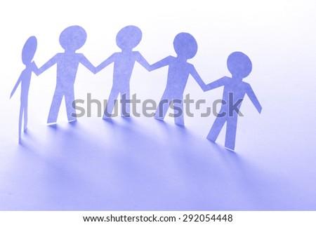 paper human team. friendship concept. studio shot - stock photo