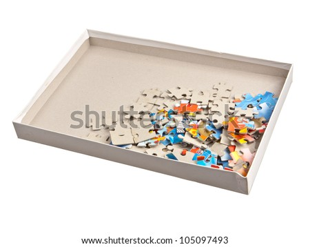 Paper Jigsaw Puzzle Pieces In Box Isolated On White Background