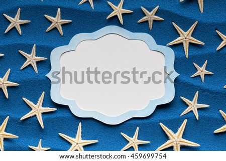 Paper label and starfish on blue background