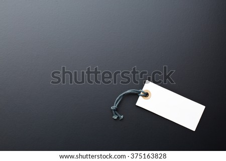 paper label on black background - stock photo