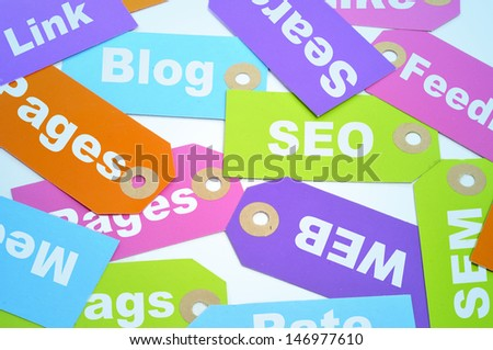 paper labels of different colors with different words about internet marketing and website ranking, such as SEO and SEM, or blog, page, web or link - stock photo