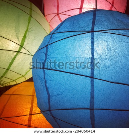 Paper lanterns of different colors. Decorative lighting. - stock photo