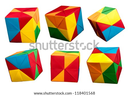 Paper made multi colored patterned cubes folded origami style. - stock photo