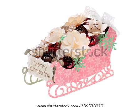 paper made sled with handmade paper flower  - stock photo