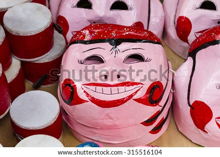 Paper masks for sale on street in Vietnam. The street are crowded and busy before Vietnamese Mid-Autumn Festival for children who receive toys, fruit and moon cake as gift - stock photo