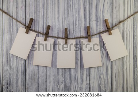 Paper nameplate on old wood background - stock photo