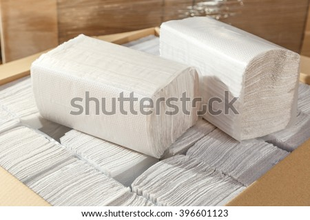 Paper napkins and towels in closeup as background