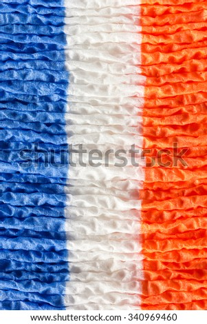paper napkins painted in the colors of the French flag - stock photo