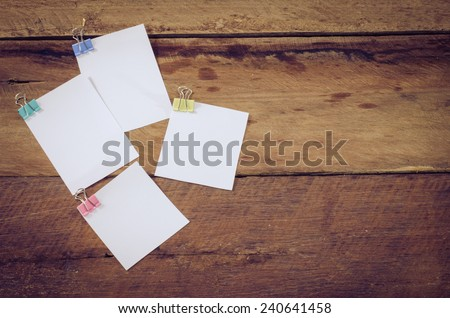 paper note on wooden background - stock photo