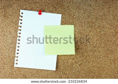 Paper note pads on cork board.
