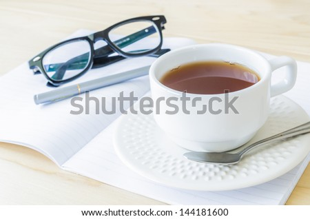 Paper note with eye glasses&white cuptea