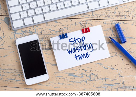 Paper note with text Stop Wasting Time - stock photo