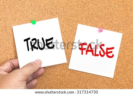 paper note with text ( true or false ) pin on corkboard  with hand holding , decision concept - stock photo