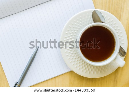 Paper note with white cup tea