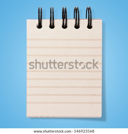 paper notebook on blue background