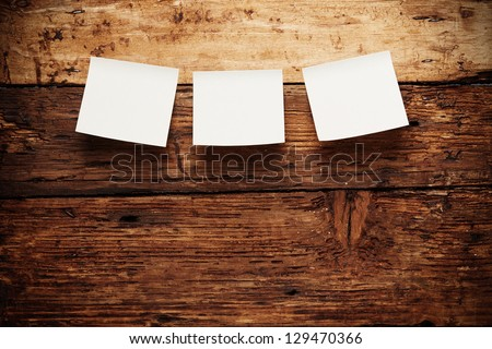 Paper notes attach to old wooden background