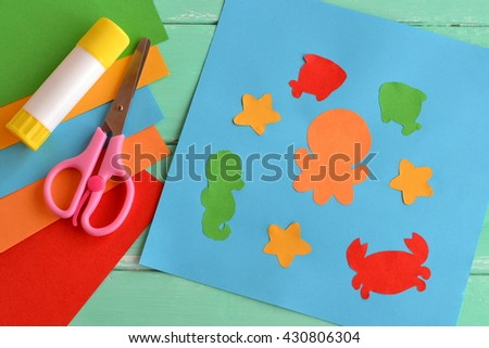 Paper ocean creatures, simple fun applique. Creative sea animal crafts for kids. Kids workshops. Creativity lesson. Scissors, glue stick, pieces of colored paper, stationery for children's art. - stock photo