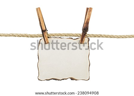 Paper on clothespins isolated on white - stock photo