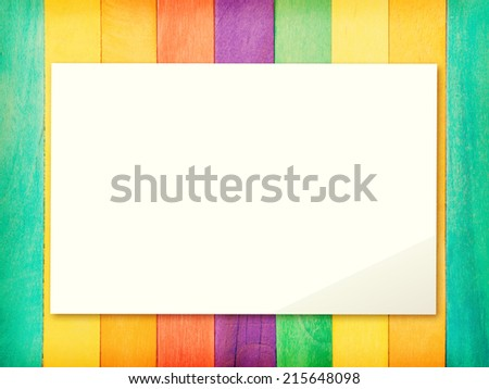paper on Colorful Wood Background