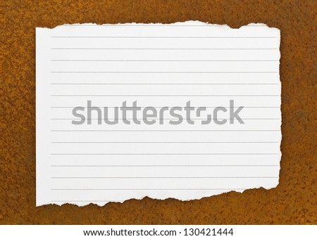 Paper on the old metal board. - stock photo