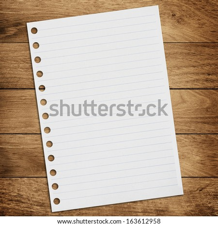 paper on the wood background - stock photo