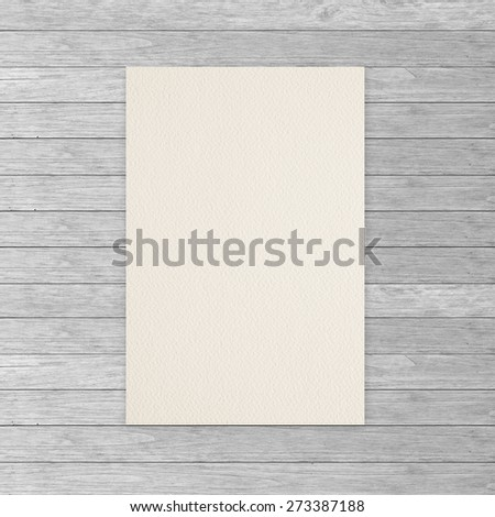 Paper on wood wall - stock photo