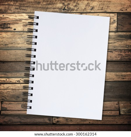 paper on wooden wall background for texture. - stock photo