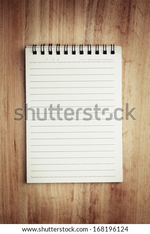 Paper page notebook. textured isolated on the wood backgrounds.