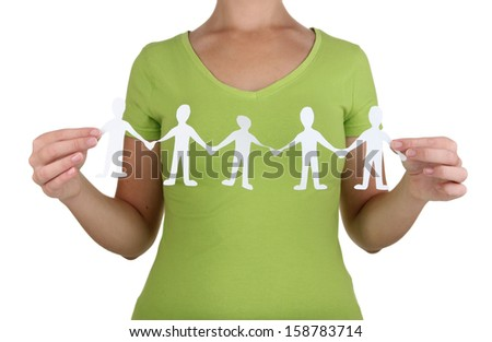 Paper people in hands isolated on white - stock photo