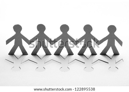 Paper people in teamwork concept