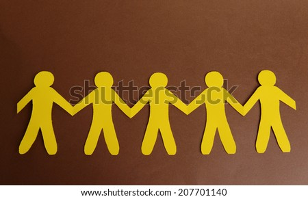 Paper people on brown background