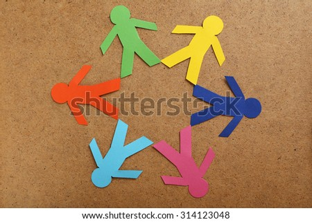 Paper people on the brown background - stock photo