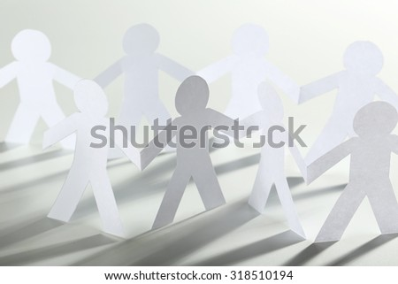 Paper people on the white background - stock photo