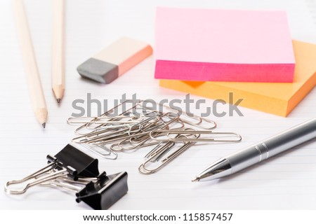 Paper pins with office supplies post-it reminder notes on notepad
