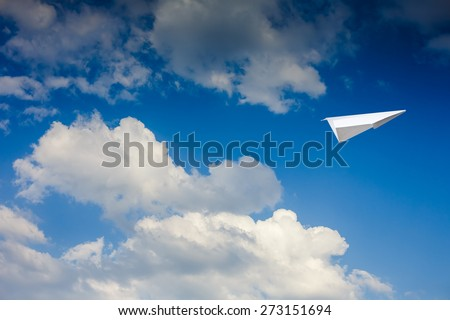 Paper plane against sky with clouds - stock photo