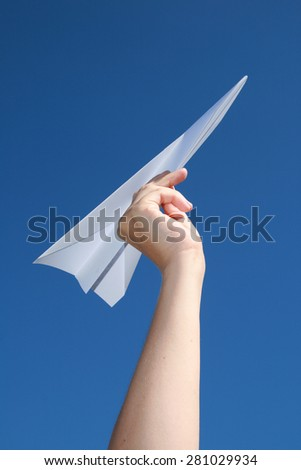 Paper plane, blue sky background - stock photo
