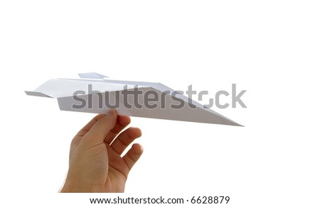Paper plane in a hand isolated on white