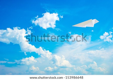 paper plane in the blue sky - stock photo