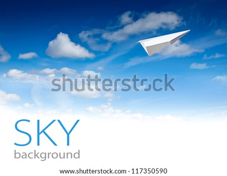 Paper planes in blue sky. Sky background - stock photo