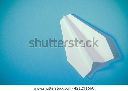 paper planes on blue background - stock photo