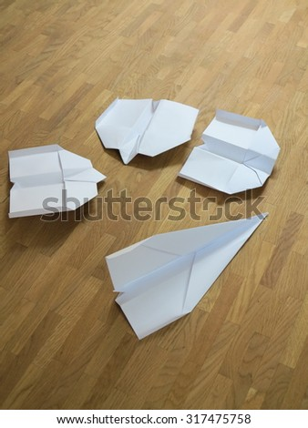 Paper planes on brown background - stock photo