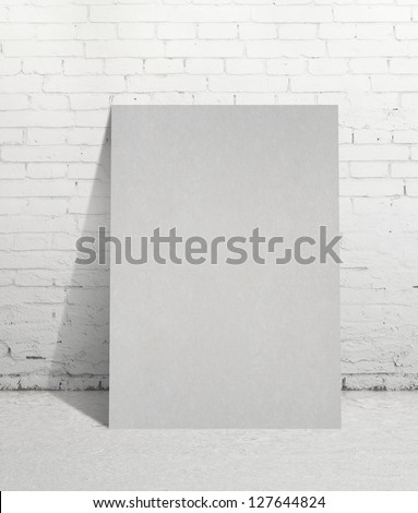 paper poster and brick wall - stock photo