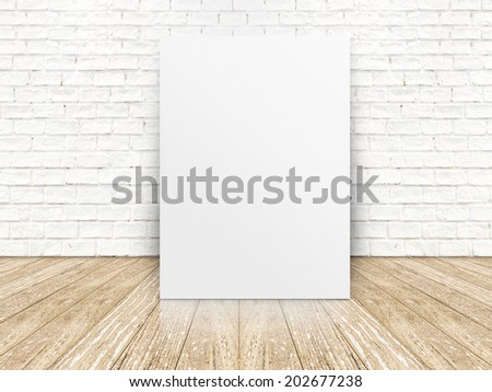 paper poster on the white  brick wall and the wood floor,template for your content - stock photo