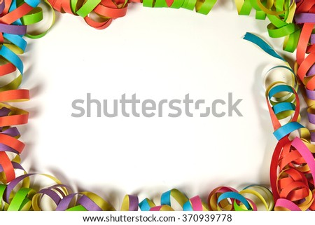 Paper ribbons in several colors make a frame for the copyspace - stock photo