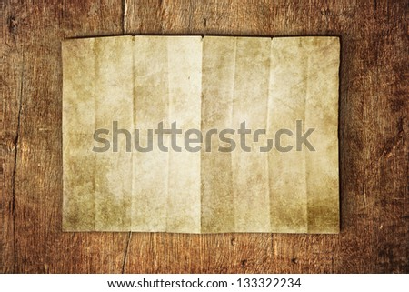 paper sheet on wooden table - stock photo