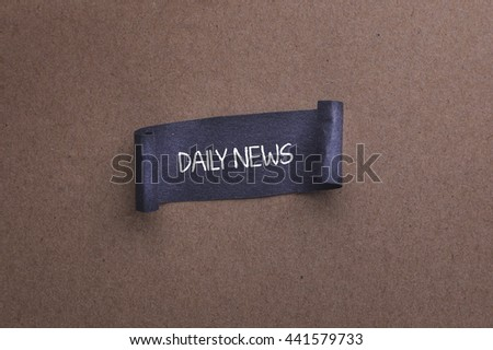 paper sheet with DAILY NEWS text on wooden background