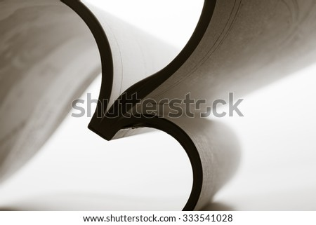 Paper sheets forming abstract curves. Toned