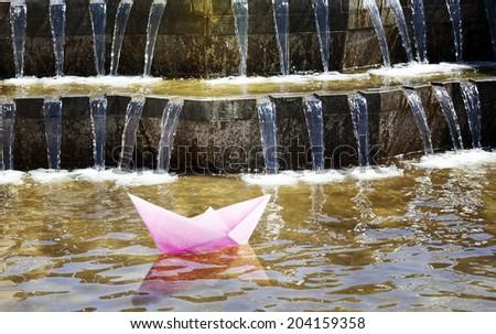 Paper ship. travel. Falls.  - stock photo