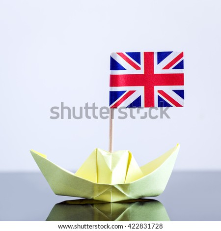 paper ship with british flag, concept shipment or free trade agreement