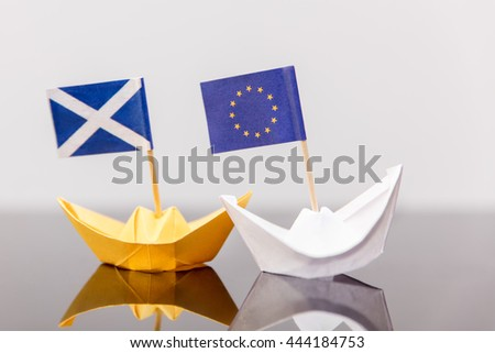 paper ship with european and scots flag, concept shipment or free trade agreement and membership of eu, independence referendum, scoxit or scexit